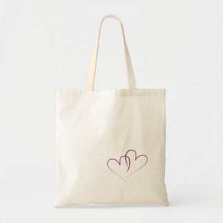 Two hearts intertwined tote bag