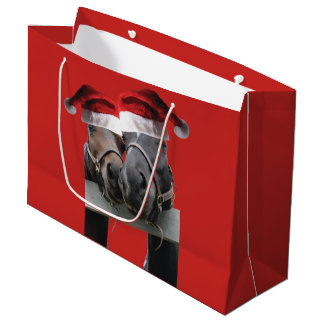 Two Horses Kissing with Santa Claus Hats on Large Gift Bag