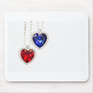 Two jewelry hearts blue and red hanging together mouse pad