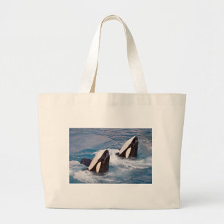 Two killer whales large tote bag