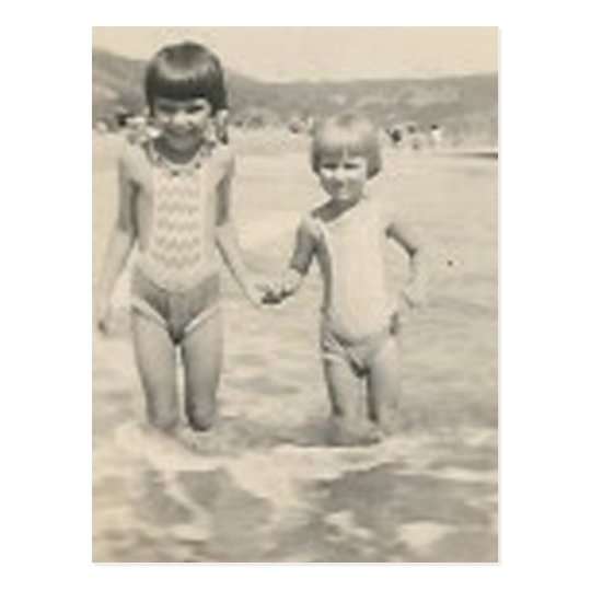 Two little girls holding hands sisters postcard