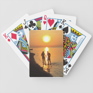 Two lovers at sunrise bicycle playing cards