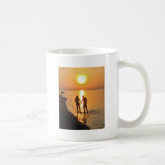 Two lovers at sunrise coffee mug