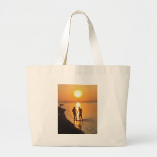 Two lovers at sunrise large tote bag
