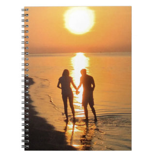 Two lovers at sunrise notebook