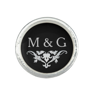 Two Monograms with Scrollwork and Leaves A36