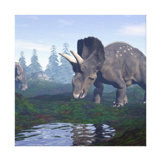 Two nedoceratops/diceratops dinosaurs walking canvas print