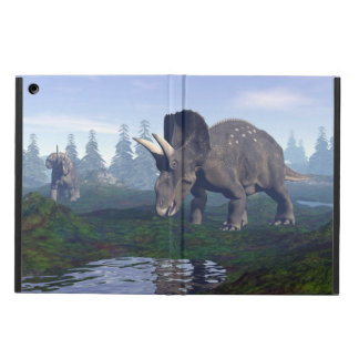 Two nedoceratops/diceratops dinosaurs walking iPad air case