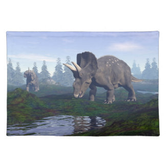 Two nedoceratops/diceratops dinosaurs walking placemat