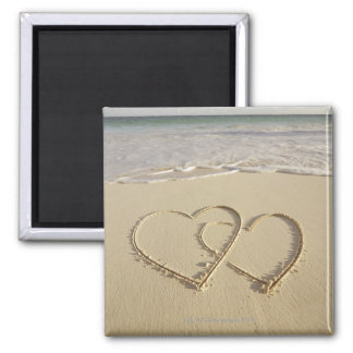 Two overlying hearts drawn on the beach square magnet