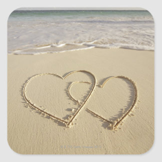 Two overlying hearts drawn on the beach square sticker