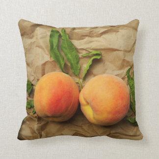 Two peaches. Conversation. Cushion