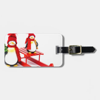 Two penguins with sleigh and christmas tree luggage tag