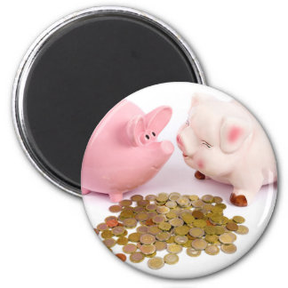 Two piggy banks with euro coins on white 6 cm round magnet