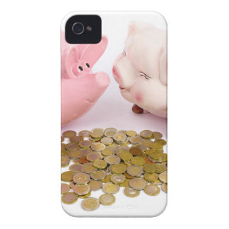 Two piggy banks with euro coins on white iPhone 4 case