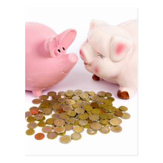 Two piggy banks with euro coins on white postcard