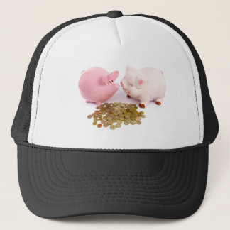 Two piggy banks with euro coins on white trucker hat