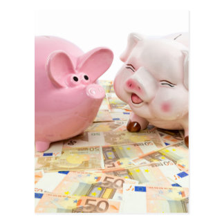 Two pink piggy banks on spread euro notes postcard