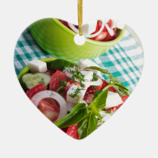 Two portions of useful vegetarian meal closeup ceramic heart decoration