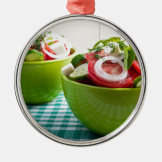 Two portions of useful vegetarian meal Silver-Colored round decoration