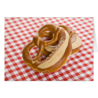 Two pretzel on checkered tablecloth card