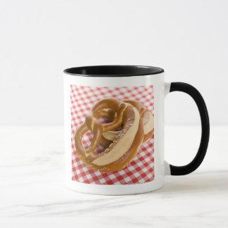 Two pretzel on checkered tablecloth mug