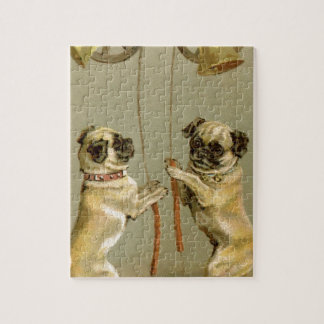 Two pug dogs ringing the Christmas bells Puzzles