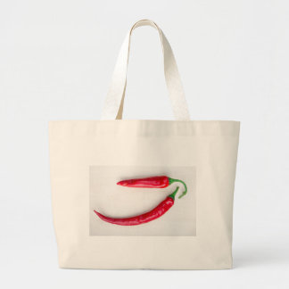 Two red hot chili pepper closeup large tote bag