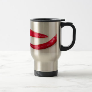 Two red hot chili peppers closeup travel mug