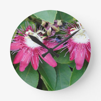 Two Red Passion Flowers Closeup Outdoors in Nature Round Clock