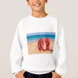 Two red slippers upright in sand of beach.JPG Sweatshirt