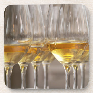 two rows of wine tasting glasses with lucious coaster