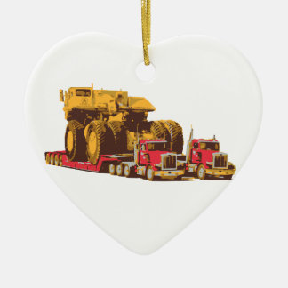 Two Semi Big Trucks carrying a Huge Mining Truck Ceramic Heart Decoration