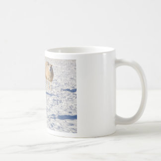 Two sheep standing in snow during winter coffee mug