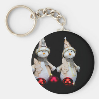 Two snowmen figurines with red baubles on black key ring