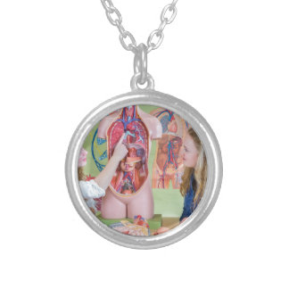 Two students learning model human body in biology. silver plated necklace