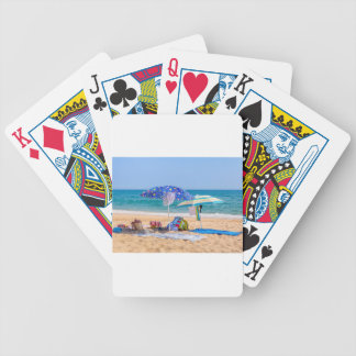 Two sun umbrellas and beach supplies at sea.JPG Bicycle Playing Cards