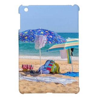 Two sun umbrellas and beach supplies at sea.JPG iPad Mini Covers