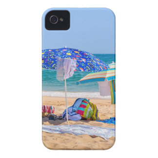 Two sun umbrellas and beach supplies at sea.JPG iPhone 4 Cover