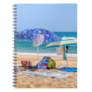 Two sun umbrellas and beach supplies at sea.JPG Notebooks