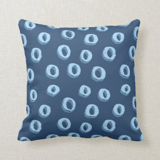 Two toned blue circles on dark blue background cushion