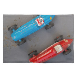 Two toy vintage cars placemats