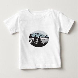 Two Trampers Sitting on Log Lake Mountain Oval Woo Baby T-Shirt