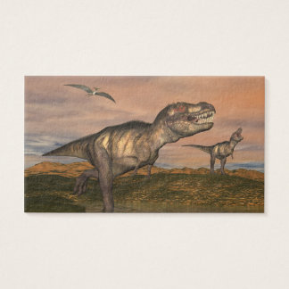 Two tyrannosaurus rex dinosaurs walking with ptera business card
