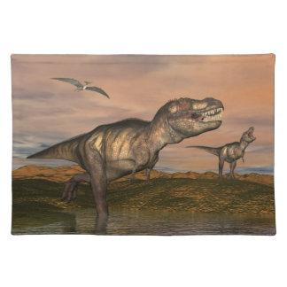 Two tyrannosaurus rex dinosaurs walking with ptera place mats