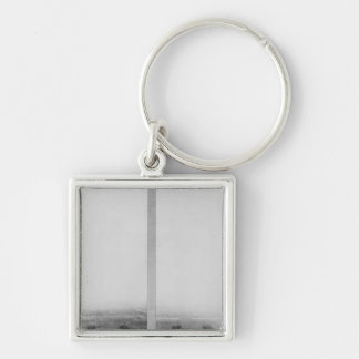 Two views of the construction of the Eiffel Silver-Colored Square Key Ring