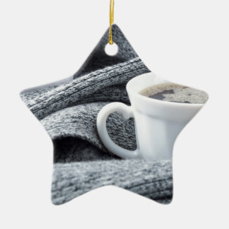 Two white cups of coffee wrapped in scarf ceramic star decoration
