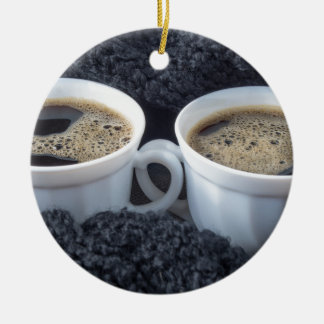 Two white cups with black coffee and foam ceramic ornament