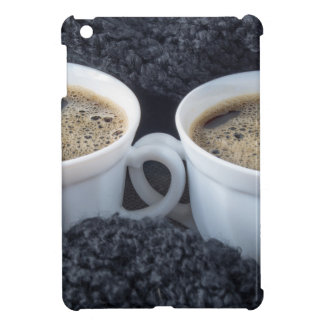 Two white cups with black coffee and foam cover for the iPad mini