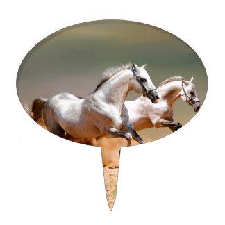two white horses running cake pick